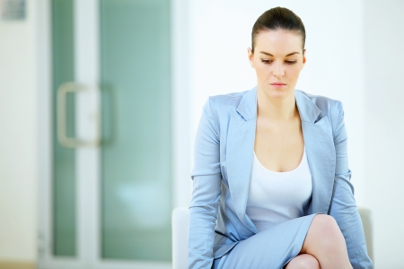 a portrait of attractive young businesswoman thinking in office Stock Photo - 17054989