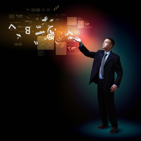 Businessman standing with modern technology symbols next to him Stock Photo - 17054929