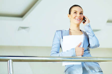 Portrait of happy smiling young businesswoman in office Stock Photo - 17054897