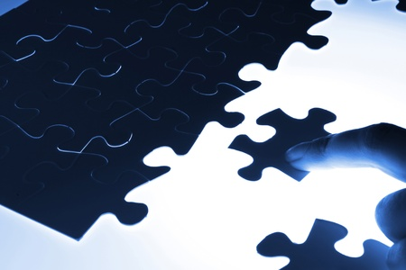 puzzle piece coming down into its place Stock Photo - 17056241