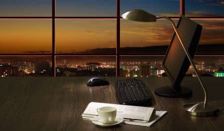 Work place in the office at night with a city view from window Stock Photo - 17056755