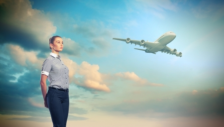 Busines person and plane on the background against cloudy sky Stock Photo - 17055991