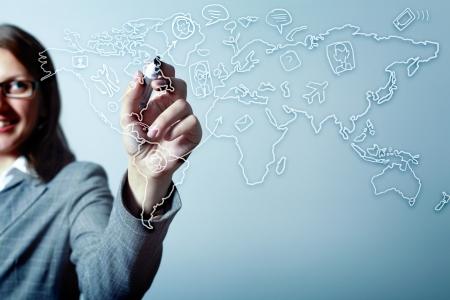 Modern Business World, A businessman navigating virtual world map Stock Photo - 17056059