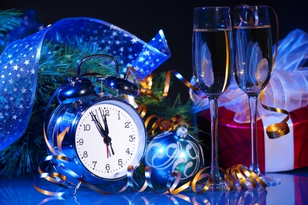 New Year s still life  Decorations and ribbons on a bright color background photo