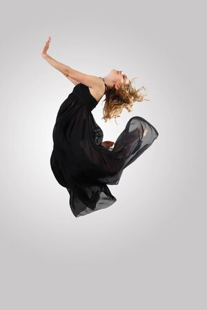 Young female dancer jumping against white background Stock Photo - 17055908