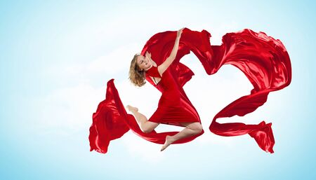 Young woman dancing with red fabric in studio and heart symbol Stock Photo - 17055943