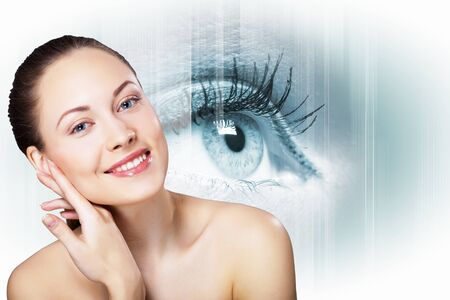 the Human eye on white background and female face photo