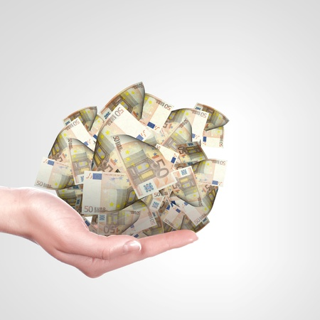 Human hand holding money on white background photo