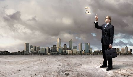 businessman in blue suit standing and juggling business symbols Stock Photo - 17056062