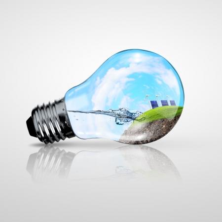 energy conservation: Green energy symbols, ecology concept, light bulb Stock Photo