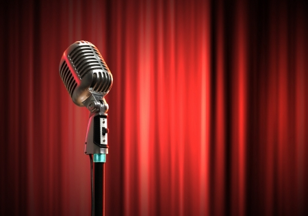 Single retro microphone against red curtains closed on the background Stock Photo - 17397860