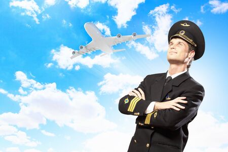 Image of male pilot with airplane at background Stock Photo - 17398404