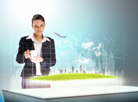 technology concept: Image of young businesswoman holding cup standing against high-tech picture