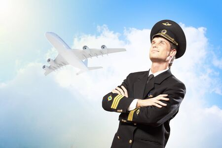 Image of male pilot with airplane at background Stock Photo - 17398151