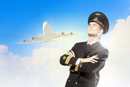 Image of male pilot with airplane at background Stock Photo - 17398462