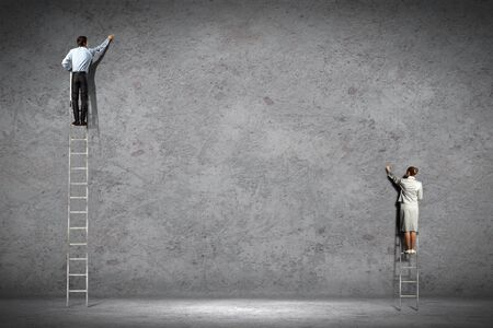 climb job ladder: businesspeople standing on ladder drawing diagrams and graphs on wall
