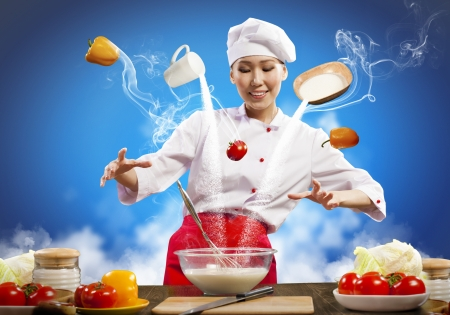 enchantment: Asian female cooking with magic against color background