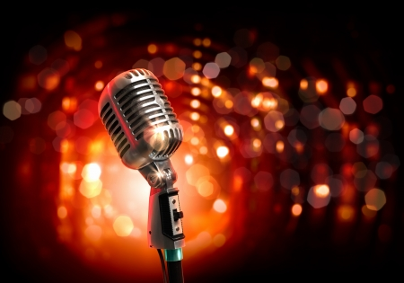 Single retro microphone against colourful background with lights Stock Photo - 17398046