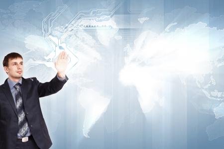 Modern Business World, A businessman navigating virtual world map Stock Photo - 17398555