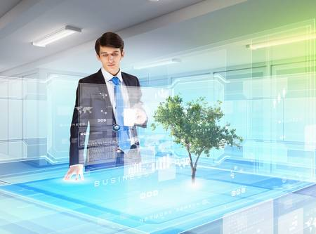 Image of young businessman against high-tech picture of environment concept photo