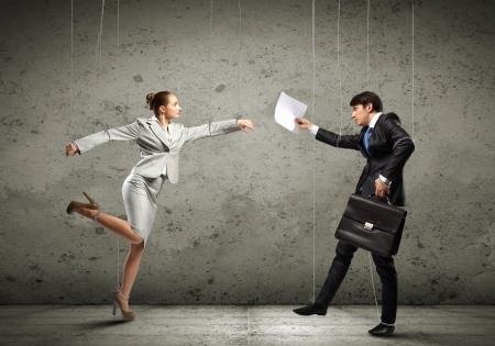 Image of businesspeople hanging on strings like marionettes  Conceptual photography Stock Photo - 17398655