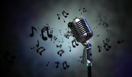 old microphone: Single retro microphone against dark background with music notes Stock Photo