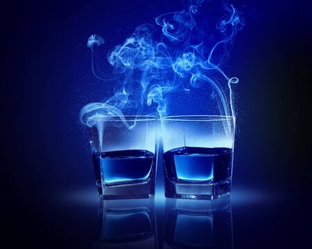 going out: Two glasses oа blue cocktail with fume going out Stock Photo