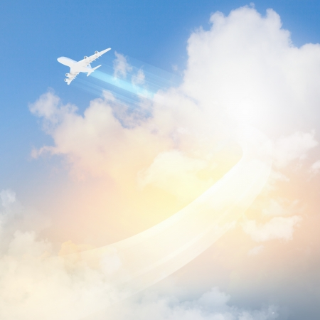 Image of flying airplane in sky with clouds at background Stock Photo - 17400270