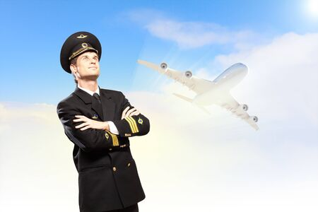 Image of male pilot with airplane at background photo