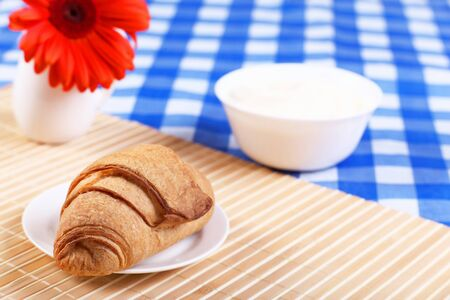 Continental breakfast with croisant on white plate photo