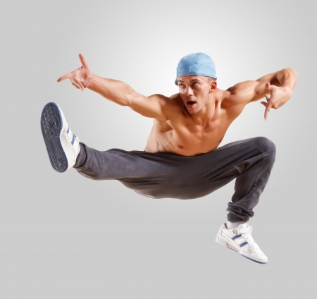young man in a blue cap dancing hip hop photo