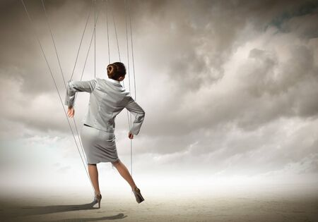 Image of businesswoman hanging on strings like manette  Conceptual photography Stock Photo - 17399998