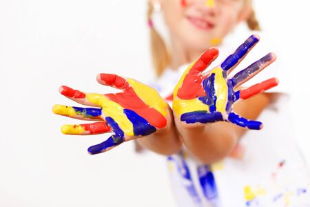 little child with hands painted in colorful paints ready for hand prints Stock Photo - 17399746