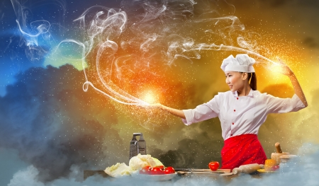 Asian female cooking with magic against color background Stock Photo - 17400280