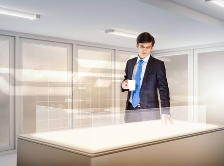 young businessman standing in background of high-tech image photo