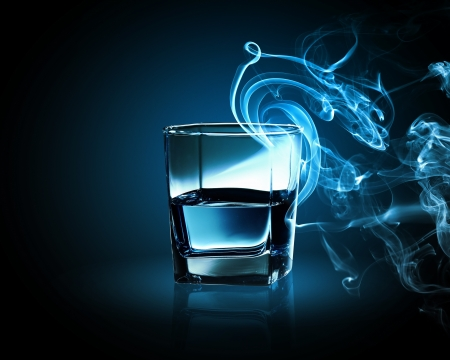 fume: Image of glass of blue cocktail with fume going out