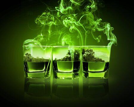 ajenjo: Tres vasos de absenta verde con la ilustración de la naturaleza en Foto de archivo