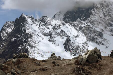 High mountains in cloud  Nepal  Everest region photo