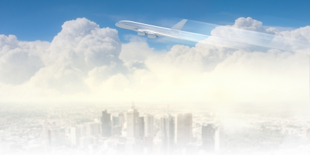 Image of flying airplane above city with clouds at background photo