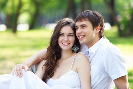 Portrait of a young romantic couple embracing each other photo