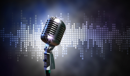 Single retro microphone against colourful background with lights Stock Photo - 17428315
