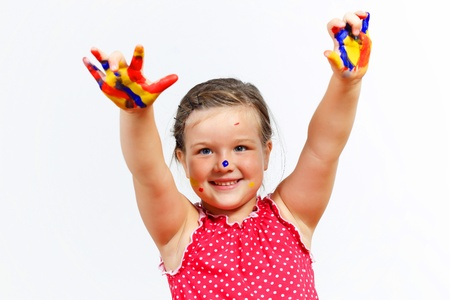 little child with hands painted in colorful paints ready for hand prints Stock Photo - 17428407