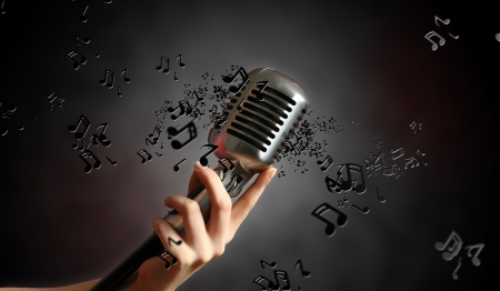 Single retro microphone against dark background with music notes Stock Photo - 17428157