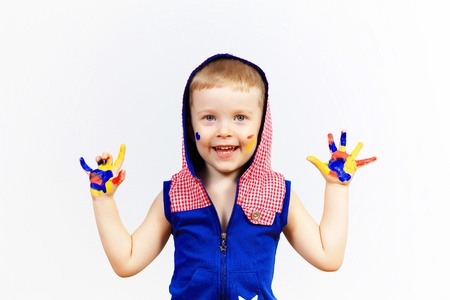 little child with hands painted in colorful paints ready for hand prints Stock Photo - 17428443