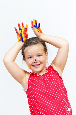 little child with hands painted in colorful paints ready for hand prints Stock Photo - 17429165