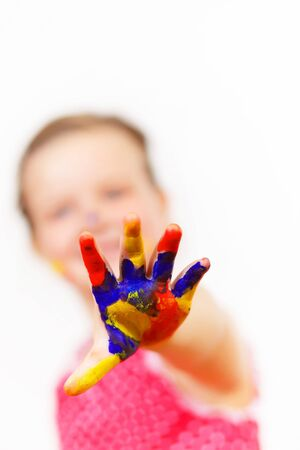 little child with hands painted in colorful paints ready for hand prints Stock Photo - 17428046