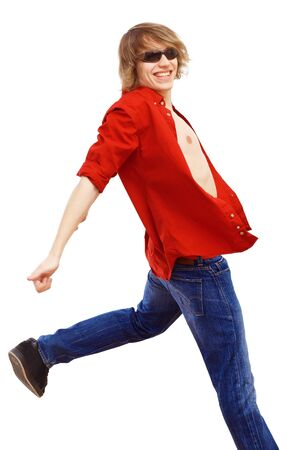 Happy smiling young man dancing and listening to music Stock Photo - 17428283