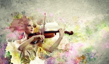 Image of beautiful female violinist playing against splashes background Stock Photo - 17494729