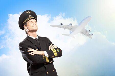 Image of male pilot with airplane at background Stock Photo - 17494515