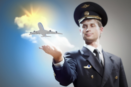 Image of pilot with airplane taking off from his hand photo
